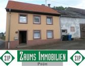 Einfamilienhaus mit Terrasse, angebautem Scheunentrakt, Garage mit großem Lagerraum - Ortskernlage!